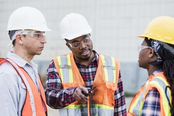 employees discussing workplace safety