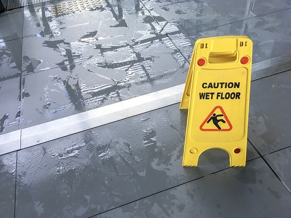 wet floor sign to promote walkway safety in the workplace