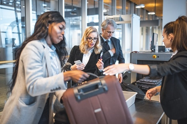 business travelers using cybersecurity tips to stay safe