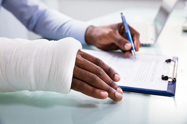 injured worker filling out workers' compensation form