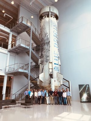 Assure Space team in front of rocket